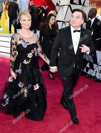 Kelly Tisdale, Mike Myers. Kelly Tisdale, left, and Mike Myers arrive at the Oscars, at the Dolby Theatre in Los Angeles