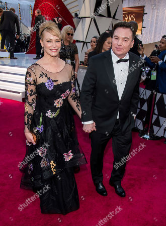 Kelly Tisdale, Mike Myers. Kelly Tisdale and Mike Myers arrive at the Oscars, at the Dolby Theatre in Los Angeles
