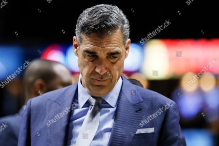 Villanova head coach Jay Wright works the bench in the second half of an NCAA college basketball game against Xavier, in Cincinnati