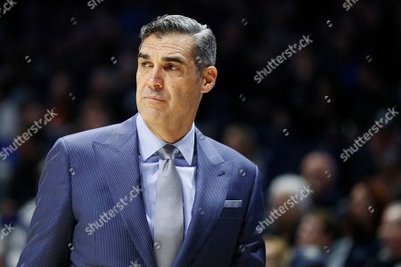 Villanova head coach Jay Wright works the bench in the first half of an NCAA college basketball game against Xavier, in Cincinnati
