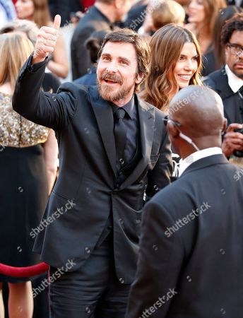 Christian Bale, Sibi Blazic. Christian Bale, left, and Sibi Blazic arrive at the Oscars, at the Dolby Theatre in Los Angeles