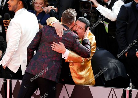 Ryan Seacrest, Guillermo Rodriguez. Ryan Seacrest, left, hugs Guillermo Rodriguez as he arrives at the Oscars, at the Dolby Theatre in Los Angeles