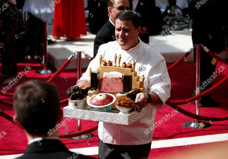 Chef Wolfgang Puck staff member arrives at the Oscars, at the Dolby Theatre in Los Angeles