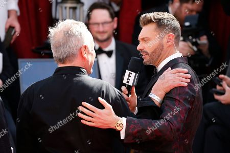 Wolfgang Puck, Ryan Seacrest. Wolfgang Puck, left, is interviewed by Ryan Seacrest at the Oscars, at the Dolby Theatre in Los Angeles