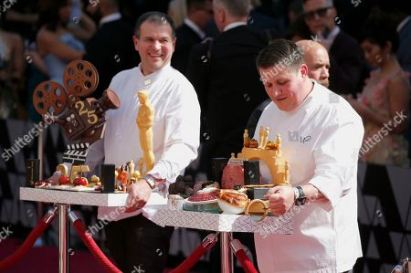 Chef Wolfgang Puck staff members arrive at the Oscars, at the Dolby Theatre in Los Angeles