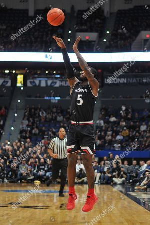 Trevor Moore (5) of the Cincinnati Bearcats shoots a three point shot during a game against the Uconn Huskies at the XL Center on , in Hartford, CT