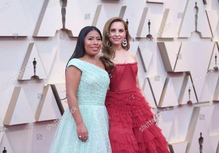 Yalitza Aparicio, Marina de Tavira. Yalitza Aparicio, left, and Marina de Tavira arrive at the Oscars, at the Dolby Theatre in Los Angeles