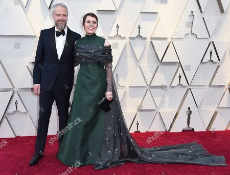 Stock Image of Ed Sinclair, Olivia Colman. Ed Sinclair, left and Olivia Colman arrive at the Oscars, at the Dolby Theatre in Los Angeles