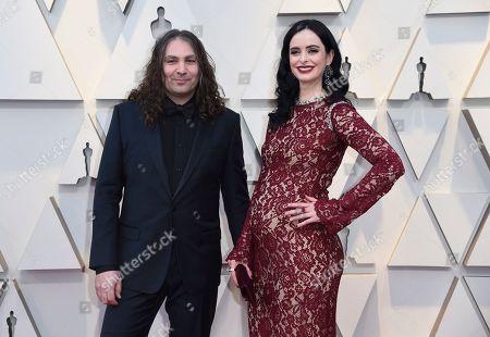 Adam Granduciel, Krysten Ritter. Adam Granduciel, left, and Krysten Ritter arrive at the Oscars, at the Dolby Theatre in Los Angeles