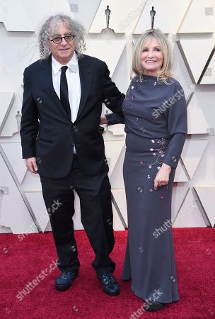 Stock Image of Hank Corwin, Nancy Corwin. Hank Corwin, left, and Nancy Corwin arrive at the Oscars, at the Dolby Theatre in Los Angeles