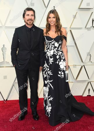 Stock Picture of Christian Bale, Sibi Blazic. Christian Bale, left, and Sibi Blazic arrive at the Oscars, at the Dolby Theatre in Los Angeles