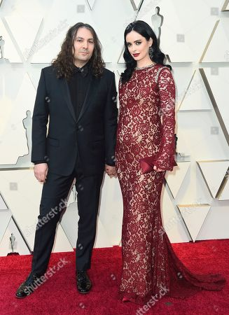Krysten Ritter, Adam Granduciel. Krysten Ritter, right, and Adam Granduciel arrive at the Oscars, at the Dolby Theatre in Los Angeles