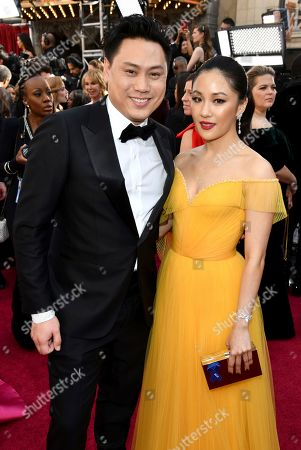 Jon M. Chu, Constance Wu. Jon M. Chu, left, and Constance Wu arrive at the Oscars, at the Dolby Theatre in Los Angeles