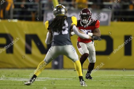 San Antonio Commanders running back Trey Williams (35) runs after the catch as San Diego Fleet defensive back Ron Brooks (33) looks to make the tackle in the second half during a San Antonio Commanders at San Diego Fleet AAF football game, at SDCCU Stadium in San Diego