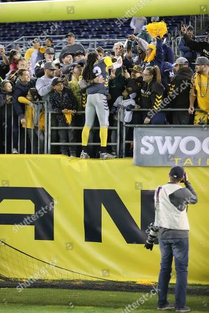 Stock Photo of San Diego Fleet defensive back Ron Brooks (33) jumps in the stands to celebrate with fans after the Fleet defeat the Commanders following a San Antonio Commanders at San Diego Fleet AAF football game, at SDCCU Stadium in San Diego