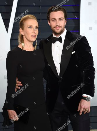 Sam Taylor-Johnson, Aaron Taylor-Johnson. Sam Taylor-Johnson, left, and Aaron Taylor-Johnson arrive at the Vanity Fair Oscar Party, in Beverly Hills, Calif