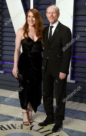 Ron Howard, Paige Howard. Ron Howard, right, and Paige Howard arrive at the Vanity Fair Oscar Party, in Beverly Hills, Calif