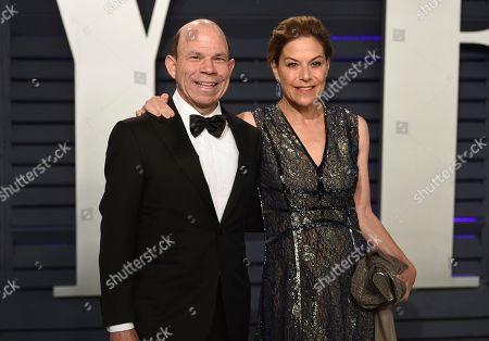 Stock Photo of Steven O. Newhouse, Gina Sanders. Steven O. Newhouse, left, and Gina Sanders arrive at the Vanity Fair Oscar Party, in Beverly Hills, Calif