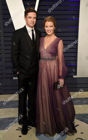 Topher Grace, Ashley Hinshaw. Topher Grace, left, and Ashley Hinshaw arrive at the Vanity Fair Oscar Party, in Beverly Hills, Calif