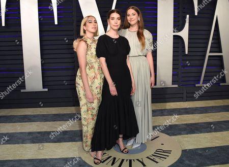 Alana Haim, Danielle Haim, Este Haim. Alana Haim, from left, Danielle Haim and Este Haim arrive at the Vanity Fair Oscar Party, in Beverly Hills, Calif