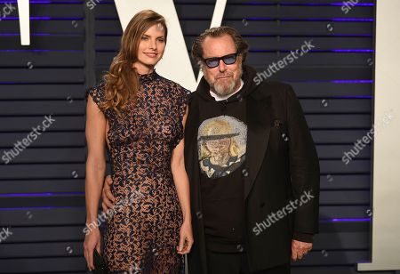 Louise Kugelberg, Julian Schnabel. Louise Kugelberg, left, and Julian Schnabel arrive at the Vanity Fair Oscar Party, in Beverly Hills, Calif