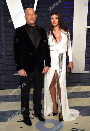 Vin Diesel, Paloma Jimenez. Vin Diesel, left, and Paloma Jimenez arrive at the Vanity Fair Oscar Party, in Beverly Hills, Calif