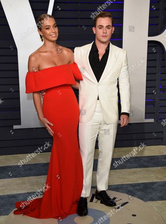 Stock Image of Liv Pollock, Dacre Montgomery. Liv Pollock, left, and Dacre Montgomery arrive at the Vanity Fair Oscar Party, in Beverly Hills, Calif