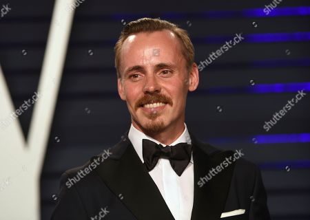 Jasper Paakkonen arrives at the Vanity Fair Oscar Party, in Beverly Hills, Calif