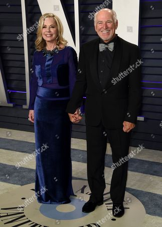 Jimmy Buffet, Jane Slagsvol. Jane Slagsvol, left, and Jimmy Buffet arrive at the Vanity Fair Oscar Party, in Beverly Hills, Calif