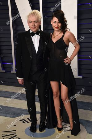 Nick Rhodes, Nefer Suvio. Nick Rhodes, left, and Nefer Suvio arrive at the Vanity Fair Oscar Party, in Beverly Hills, Calif
