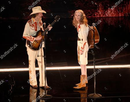 """Stock Photo of David Rawlings, Gillian Welch. David Rawlings, left, and Gillian Welch perform """"When A Cowboy Trades His Spurs For Wings"""" from the film """"The Ballad of Buster Scruggs"""" at the Oscars, at the Dolby Theatre in Los Angeles"""