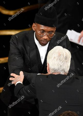 "Sam Elliott, Mahershala Ali. Sam Elliott, right, congratulates Mahershala Ali in the audience as he is announced the winner for best performance by an actor in a supporting role for ""Green Book"" at the Oscars, at the Dolby Theatre in Los Angeles"