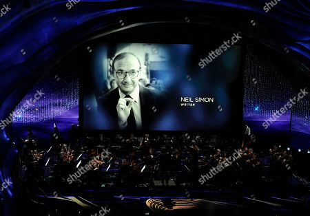 Gustavo Dudamel, Neil Simon. Gustavo Dudamel conducts the LA Philharmonic performance during the 'In Memoriam' at the Oscars, at the Dolby Theatre in Los Angeles as the late writer Neil Simon is pictured on screen