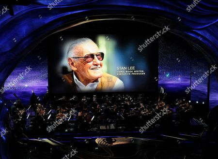 Gustavo Dudamel, Stan Lee. Gustavo Dudamel conducts the LA Philharmonic performance during the 'In Memoriam' at the Oscars, at the Dolby Theatre in Los Angeles as the late Stan Lee is pictured on screen