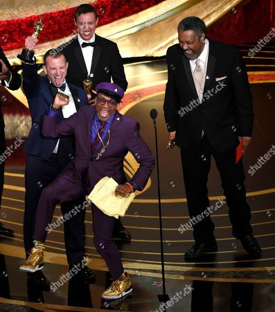 "Charlie Wachtel, Spike Lee, David Rabinowitz, Kevin Willmott. Spike Lee, foreground center, Charlie Wachtel, from left, David Rabinowitz and Kevin Willmott accept the award for best adapted screenplay for ""BlacKkKlansman"" at the Oscars, at the Dolby Theatre in Los Angeles"