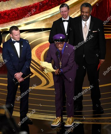 "Charlie Wachtel, Spike Lee, David Rabinowitz, Kevin Willmott. Charlie Wachtel, from left, Spike Lee, David Rabinowitz and Kevin Willmott accept the award for best adapted screenplay for ""BlacKkKlansman"" at the Oscars, at the Dolby Theatre in Los Angeles"