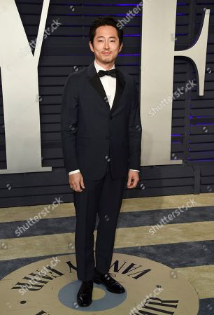 Steven Yeun arrives at the Vanity Fair Oscar Party, in Beverly Hills, Calif