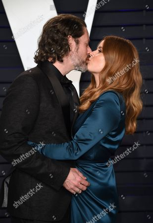 Amy Adams, Darren Le Gallo. Amy Adams, right, and Darren Le Gallo kiss at the Vanity Fair Oscar Party, in Beverly Hills, Calif