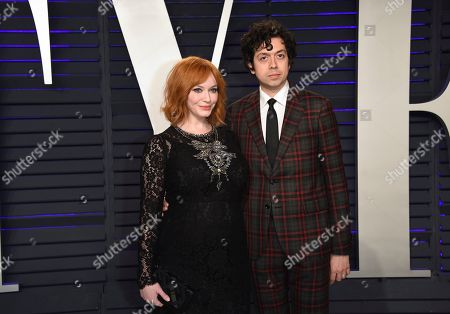 Christina Hendricks, Geoffrey Arend. Christina Hendricks, left, and Geoffrey Arend arrive at the Vanity Fair Oscar Party, in Beverly Hills, Calif