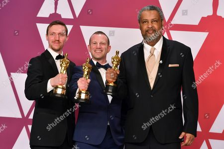 "David Rabinowitz, Charlie Wachtel, Kevin Willmott. David Rabinowitz, from left, Charlie Wachtel, and Kevin Willmott, winners of the award for best adapted screenplay for ""BlacKkKlansman"", pose in the press room at the Oscars, at the Dolby Theatre in Los Angeles"