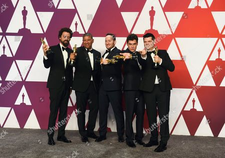 """Bob Persichetti, Peter Ramsey, Rodney Rothman, Phil Lord, Christopher Miller. Bob Persichetti, from left, Peter Ramsey, Rodney Rothman, Phil Lord and Christopher Miller pose with the award for best animated feature film for """"Spider-Man: Into the Spider-Verse"""" in the press room at the Oscars, at the Dolby Theatre in Los Angeles"""