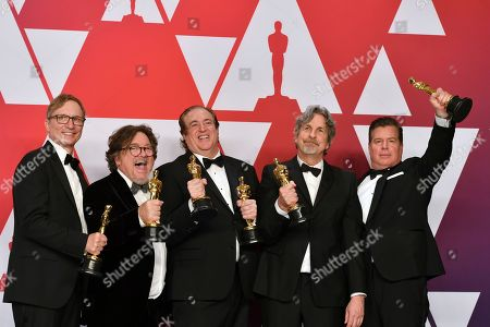 "Jim Burke, Charles B. Wessler, Nick Vallelonga, Peter Farrelly, Brian Currie. Jim Burke, from left, Charles B. Wessler, Nick Vallelonga, Peter Farrelly, and Brian Currie pose with the award for best picture for ""Green Book"" in the press room at the Oscars, at the Dolby Theatre in Los Angeles"