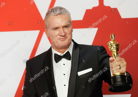 John Ottman winner of the Film Editing Award for 'Bohemian Rhapsody' poses in the press room during the 91st annual Academy Awards ceremony at the Dolby Theatre in Hollywood, California, USA, 24 February 2019. The Oscars are presented for outstanding individual or collective efforts in 24 categories in filmmaking.