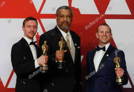 David Rabinowitz (L) Kevin Willmott (C) and Charlie Wachtel (R) winners of the Best Adapted Screenplay Award for 'BlacKkKlansman' pose in the press room during the 91st annual Academy Awards ceremony at the Dolby Theatre in Hollywood, California, USA, 24 February 2019. The Oscars are presented for outstanding individual or collective efforts in 24 categories in filmmaking.