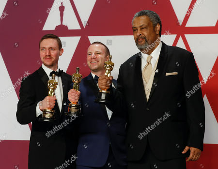 David Rabinowitz (L) Charlie Wachtel (C) and Kevin Willmott (R) winners of the Best Adapted Screenplay Award for 'BlacKkKlansman' pose in the press room during the 91st annual Academy Awards ceremony at the Dolby Theatre in Hollywood, California, USA, 24 February 2019. The Oscars are presented for outstanding individual or collective efforts in 24 categories in filmmaking.
