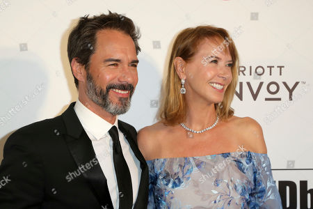 Stock Image of Eric McCormack, Janet Holden. Eric McCormack, left, and Janet Holden arrive at the 2019 Elton John AIDS Foundation Oscar Viewing Party, in West Hollywood, Calif
