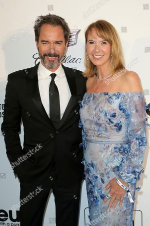 Eric McCormack, Janet Holden. Eric McCormack, left, and Janet Holden arrive at the 2019 Elton John AIDS Foundation Oscar Viewing Party, in West Hollywood, Calif