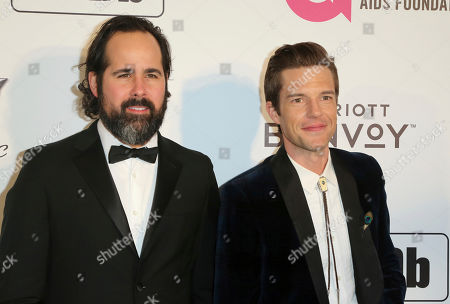 Stock Image of Brandon Flowers, Ronnie Vannucci Jr., The Killers. Ronnie Vannucci Jr., left, and Brandon Flowers both members of the American rock band The Killers arrive at the 2019 Elton John AIDS Foundation Oscar Viewing Party, in West Hollywood, Calif