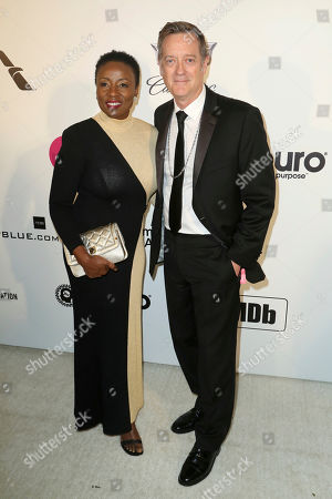 Joni Bovill, Kirk Bovill. Joni Bovill, left, and Kirk Bovill arrive at the 2019 Elton John AIDS Foundation Oscar Viewing Party, in West Hollywood, Calif