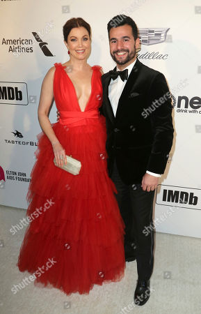 Bellamy Young, Ed Weeks. Bellamy Young, left, and Ed Weeks arrive at the 2019 Elton John AIDS Foundation Oscar Viewing Party, in West Hollywood, Calif